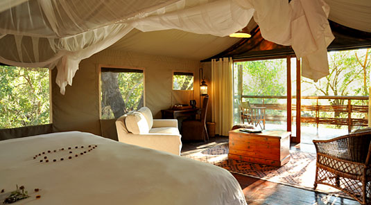 Thakadu River Camp - TSented Suite Bedroom & Deck - Madikwe Game Reserve